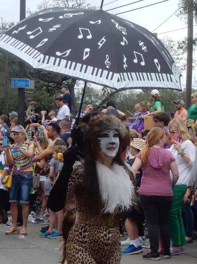 Amazing costumes like this cat costume scour the city during Mardi Gras in New Orleans. Get your ultimate guide for surviving Mardi Gras over at adventuresofb2.com