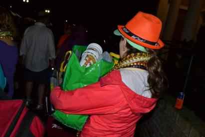 Truth: You don't have to flash to get beads. Here one parade goer carrying her bag of beads home from a day at the parades. Get more great tips for surviving mardi gras over at adventuresofb2.com