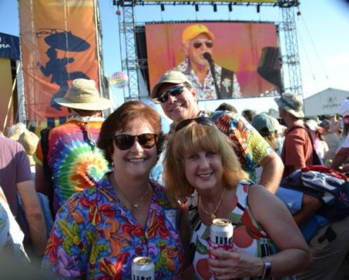 A group enjoying live music from Jimmy Buffett at the New Orleans Jazz Festival. Enjoy the unique food, culture and music here at the top New Orleans Festival. - Adventures of B2