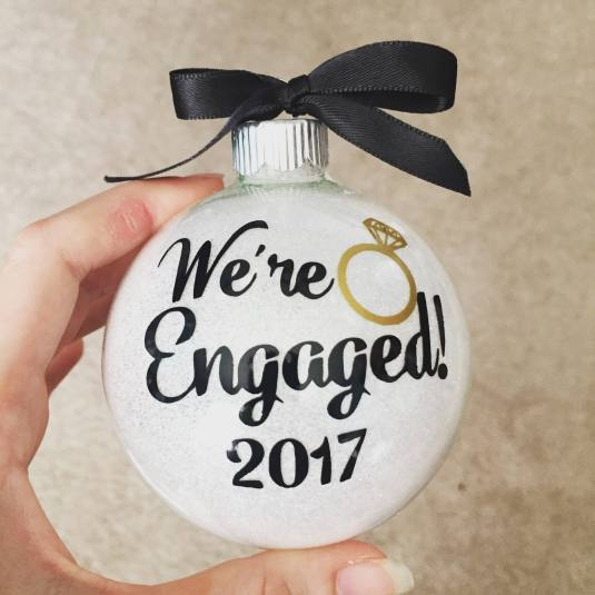 Newly engaged or married friends will love this special keepsake. Personalized engagement ornaments from EatLiveLoveNOLA make the perfect wedding present or Christmas gift idea! #christmas #giftideas #newlyweds #engaged #wedding