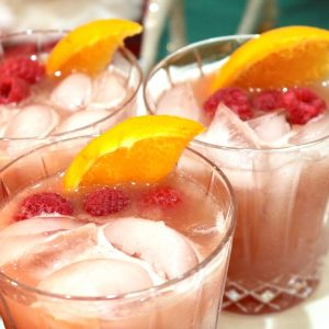 A winter bourbon punch full of bold fruity flavors and whiskey that is perfect for any bourbon lover! This alcoholic drink is perfect for sipping while hanging with friends by the tree or bringing in the new year!