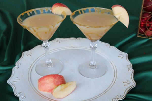 Grab a friend and sip on a delicious fall holiday cocktail. This salted caramel apple martini is so delicious and full of caramel and fresh apple flavor! Serve at a Christmas party or other holiday party to surprise your gets with a fun drink!