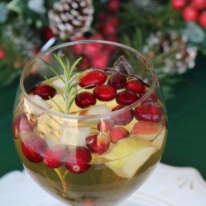 White Christmas sangria is a delicious holiday drink that combines flavors of white wine, brandy, apple cider, apples and cranberries for a light fruity cocktail. This Christmas sangria is perfect for all holiday celebrations!