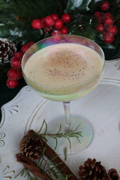 A delicious classic cocktail to enjoy this holiday season. Eggnog Cocktail is a delicious dessert martini with eggnog, amaretto, and vodka that is perfect for holiday parties!