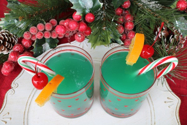 The bright festive green drink will be a hit at your next party! Inspired by the grinch movie, this holiday cocktail will get anyone into the Christmas spirit with its fruity flavor.