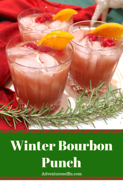 Winter Bourbon Punch is a light fruity cocktail composed of whiskey and juices of raspberry and orange. Refreshing and so easy to make for your next holiday party. #christmascocktail #holldaydrinks #whiskey #bourbon