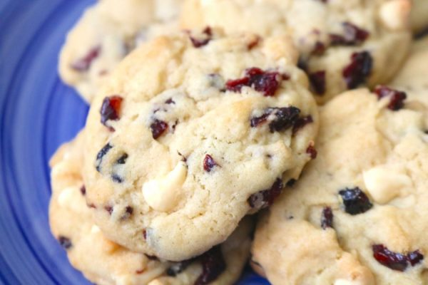 White chocolate cranberry cookies are super soft and chewy and bursting with white chocolate chips and dried cranberries. A fantastic easy to make cookie recipe- adventuresofb2.com