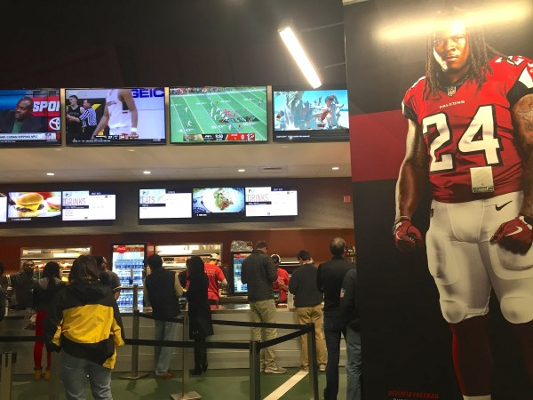 The concessions at atlanta falcons stadium during the saints vs falcons game. Much different from the supermodel, the concessions are lined with tons of tvs on different sports stations for you to keep up with all sporting events. - adventures of b2