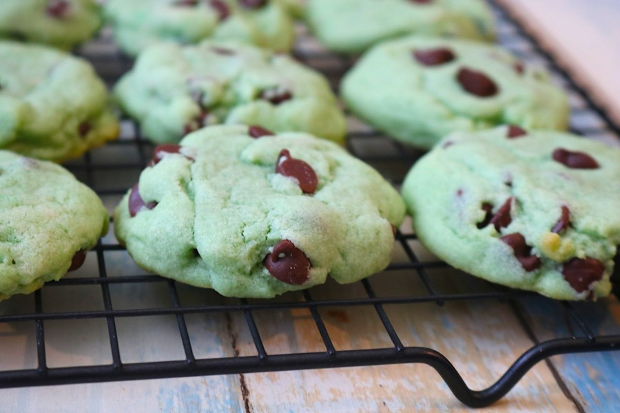 Mint Chocolate Chip cookies are made up of peppermint cookie dough, studded with plenty of chocolate chips. It's your favorite ice cream in cookie form - the perfect summer cookie or great for holidays like Christmas and St. Patrick's Day with these green tinted mint cookies! - Adventuresofb2.com