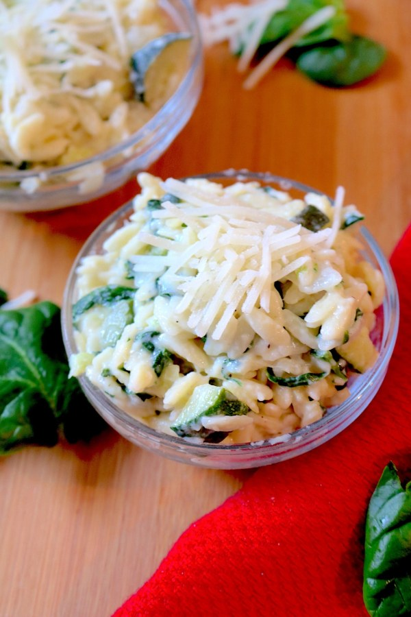Creamy Zucchini and Parmesan Orzo is a light and creamy orzo pasta packed with veggies which makes it a perfect side dish to your meal. In 30 minutes or less, you can have a delicious pasta to complete your meal! - Adventuresofb2.com