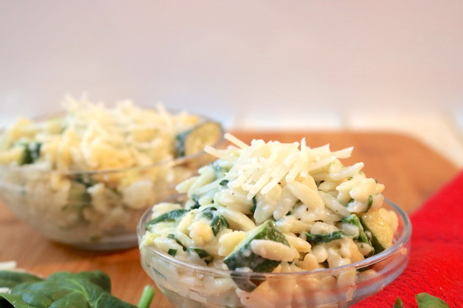 creamy parmesan orzo pasta is a light creamy pasta loaded with vegetables and sprinkled with cheese. A delightful pasta that compliments any meal.- Adventuresofb2.com