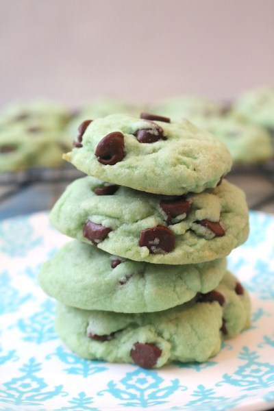 Mint Chocolate Chip cookies are made up of peppermint cookie dough, studded with plenty of chocolate chips. It's your favorite ice cream in cookie form - the perfect summer cookie or great for holidays like Christmas and St. Patrick's Day with these green tinted mint cookies! - Adventuresofb2.com #cookies #chocolate #mint #stpatricksday #winter #summer #christmas