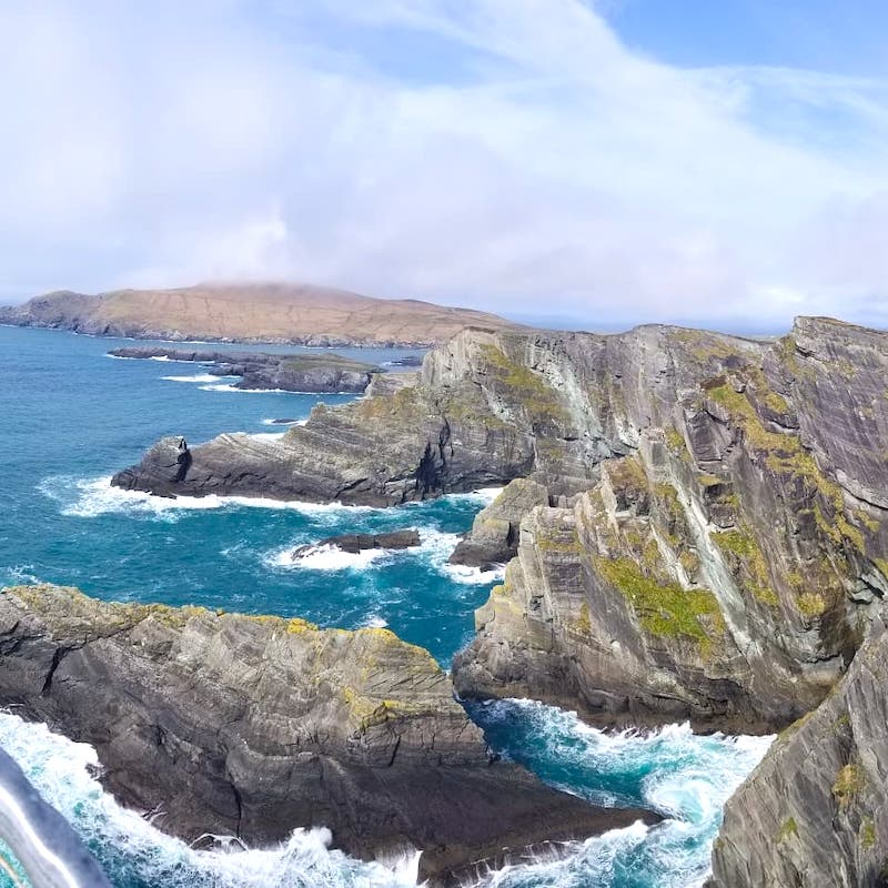 Veer off the Ring of Kerry to see some beautiful sights as pretty as the Cliffs of Moher. The Kerry Cliffs a breathtaking site to see on your road trip through Ireland! - Adventuresofb2.com