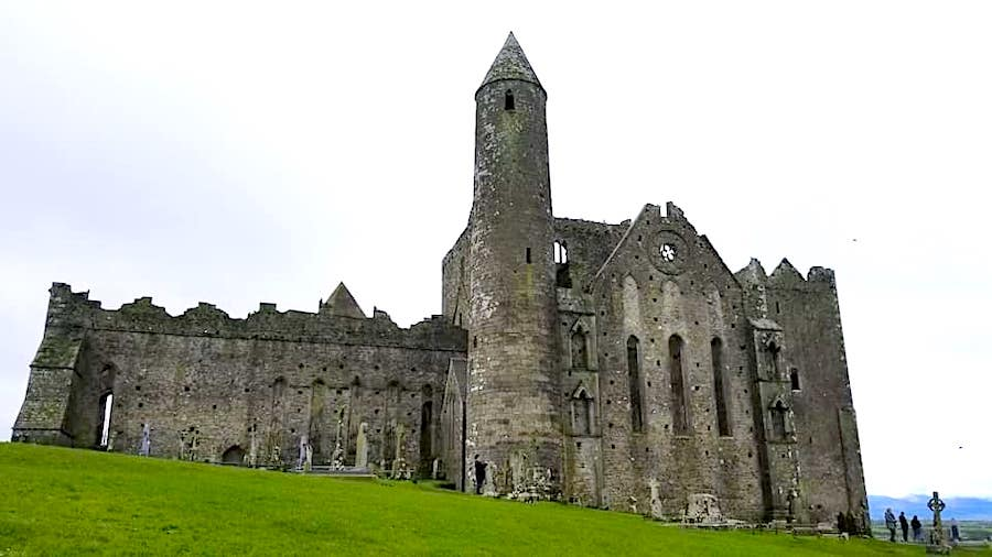 Rock of Cashel set of medieval buildings for tourist to come a marvel at. A perfect stop on an ireland road trip. - Adventuresofb2.com