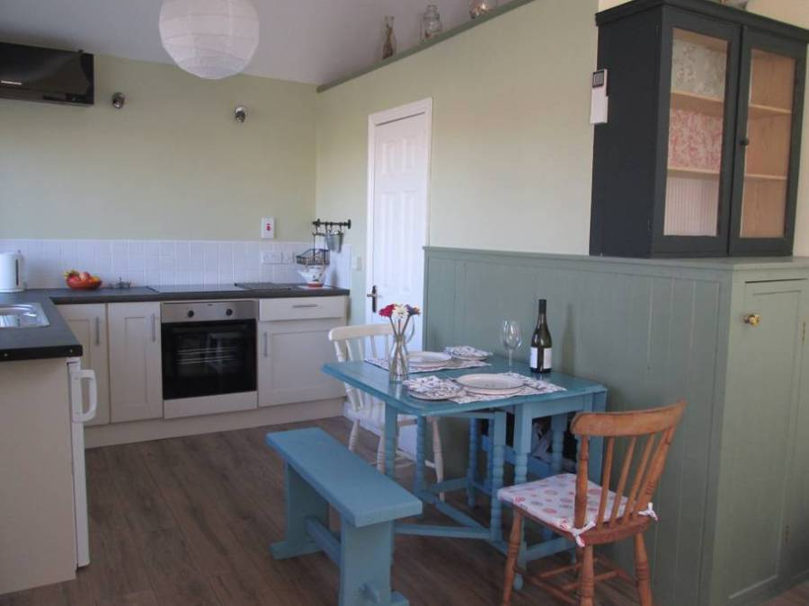 Tramore Airbnb guesthouse complete with a patio. Right on the water so you can head down to the beach. A perfect stop on the your road trip through Ireland! - Adventuresofb2.com