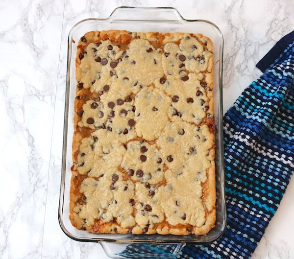 chocolate chip caramel bars baked to perfection. Soft chocolate chip cookie dough with a layer of creamy delicious caramel sauce topped with another layer of your favorite chocolate chip cookie dough. It'll satisfy any sweet tooth with it's creamy rich decadent layers. - adventures of b2