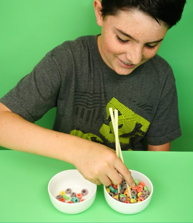 Test your childs fine motor skills with this fun game with cereal! A minute to win it with chopsticks and froot loops. The student must use the chopsticks to transfer fruit loops from one bowl to another. Who will win?! - Adventuresofb2