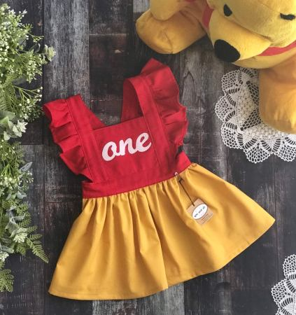 Celebrate your little girls first birthday with this adorable winnie the pooh themed dress!