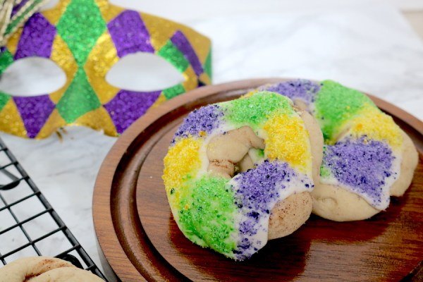 Mardi Gras is right around the corner and king cake season is in full effect. This mardi gras king cake cookies will satisfy all your king cake needs with a unique twist on the original king cake. Soft sugar cookie with cinnamon filling topped with icing and purple, green, and gold sprinkles. - Adventures of B2