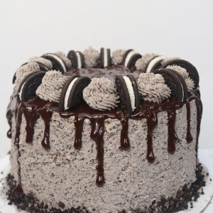Oreo cookies and cream drip cake is the perfect celebration cake! It is loaded with Oreo cookies. It's a 3 layer simple white cake with bits of cookies and cream with oreo buttercream layered in between with chocolate ganache. It's every cookie lover's dream! - adventuresofb2.com