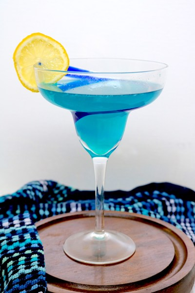 Cruiser Punch is a fun blue cocktail made with lemonade, rum, blue curaco and club soda or soda water. Perfect for a police themed date night. - Adventures of B2