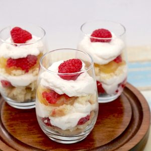 Lemon Raspberry Trifles are the perfect summer dessert. Individually portioned in mini dessert glasses, they won't last long! Soft lemon raspberry cookies layered with lemon curd, fresh raspberries and whip cream. An explosion of lemon raspberry in every bite! - adventuresofb2.com