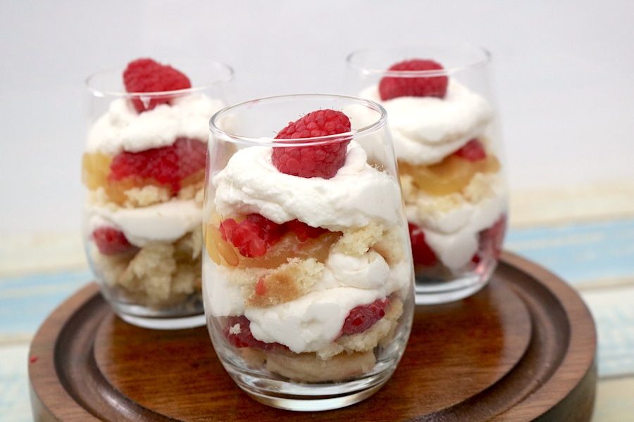 Mini Lemon Raspberry Trifles are mini desserts with an burst of lemon and raspberry flavors in every bite. Delicious layers of soft lemon pound cake with fresh raspberries, lemon curd and whipped cream. - adventuresofb2.com