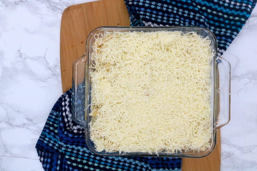Chicken alfredo bake is an easy weeknight meal the whole family will love. With bits of juicy chicken and pasta in a creamy sauce topped with more mozzarella cheese.