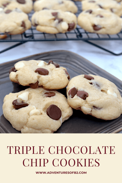 Triple chocolate chip cookies are the ultimate chocolate chip cookies. A traditional chocolate chip cookie exploded with 3 different chocolates (white, dark and milk chocolate). It's hard to eat just one! - adventuresofb2.com #cookies #chocolatechip #chocolatelovers