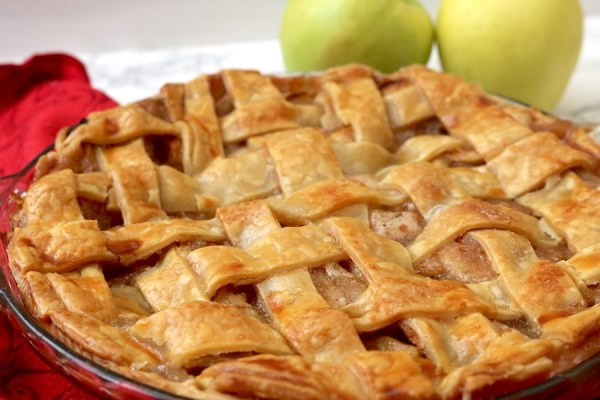 Delicious and stress-free homemade apple pie - complete with a tender and flaky crust, juicy apples in a cinnamon-spiced filling - is totally achievable with this easy recipe for classic apple pie from scratch!