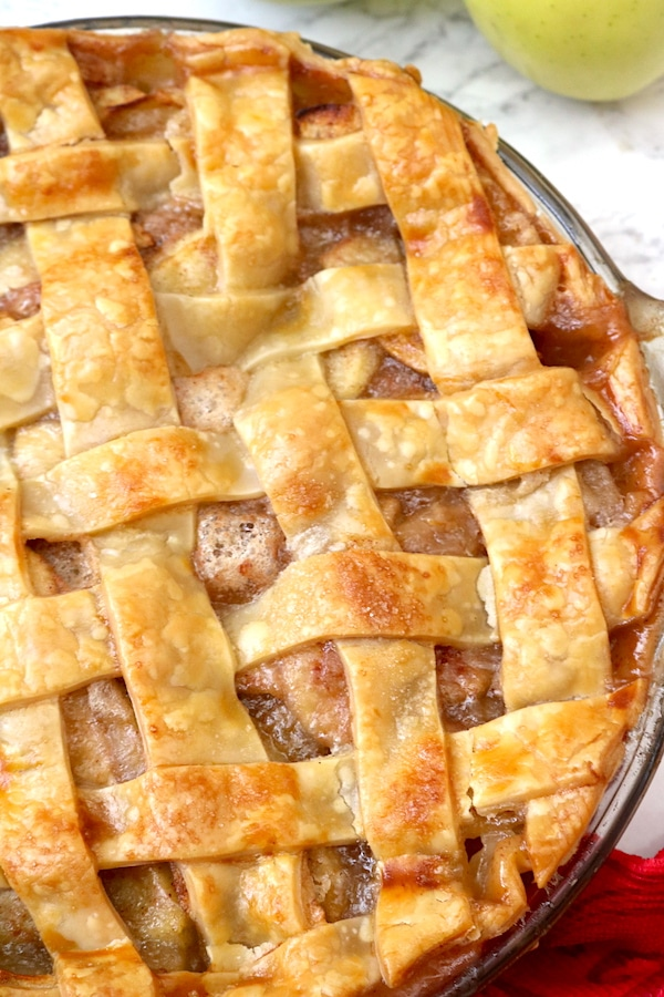 A flaky, delicious Classic Apple Pie Recipe is perfect for dessert all year round! Filled with juicy apples in a cinnamon-coated filling all tucked into a golden flaky pie crust and baked to perfection!