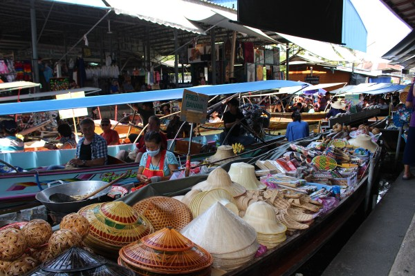 Ten reasons to visit Thailand and a colorful boat at the floating market.