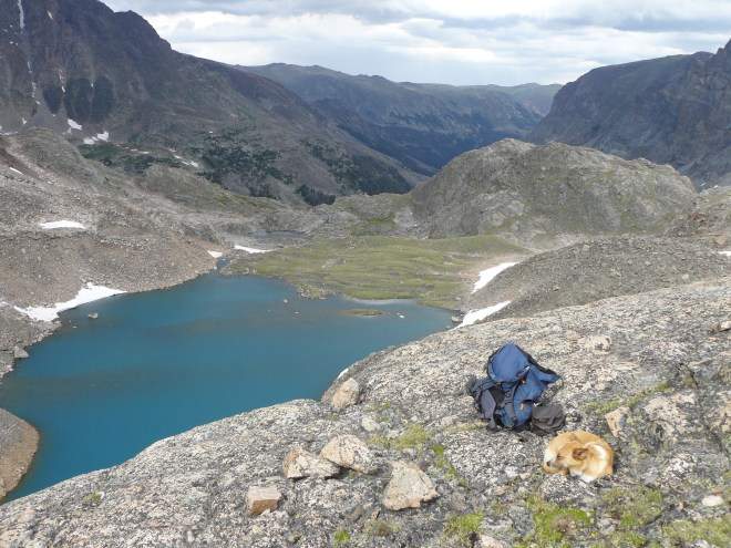 Lupe rests on the final ridge above beautiful Sky Pilot Lake in the Beartooth Mountains of Montana 7-17-13