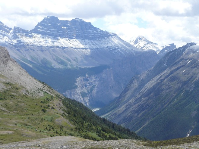 The E end of the Saskatchewan Glacier valley as seen from Parker Ridge. The Icefields Parkway Hwy 93 is visible way down below.