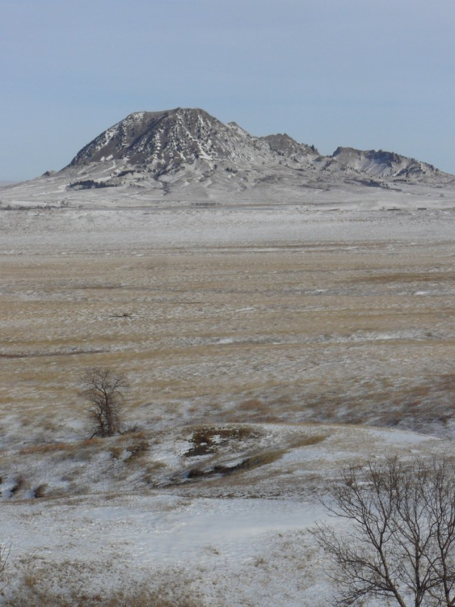 Looking NE at Bear Butte from Centennial Trail No. 89. Bear Butte Lake is barely visible over the top of the second big ridge ahead.