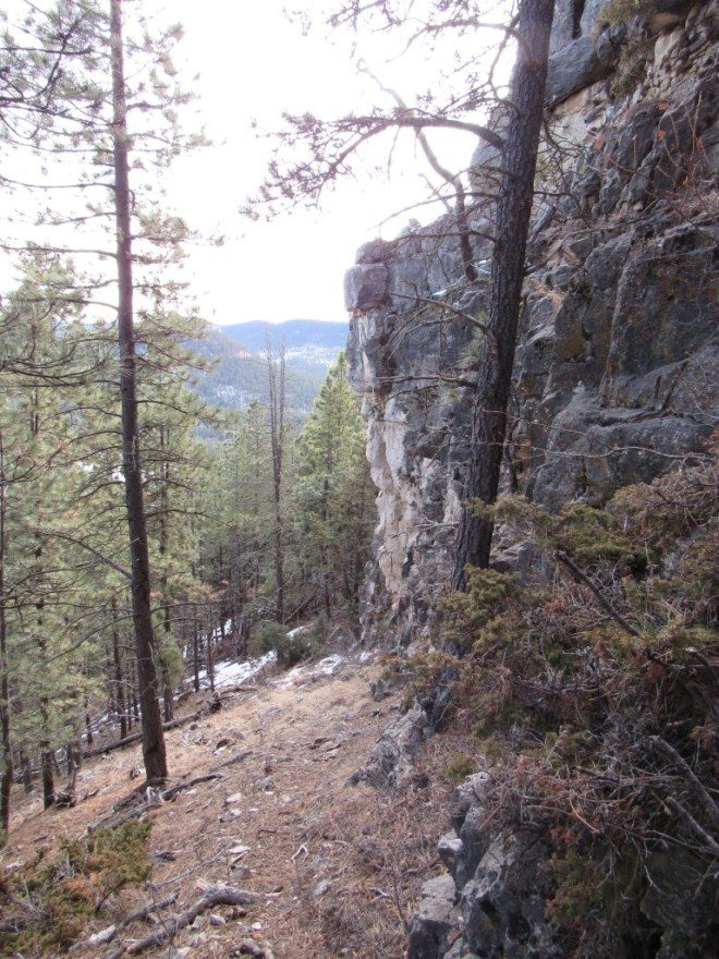 Lupe's route going down below the upper band of cliffs on the E side of Steamboat Rock. Photo looks S.