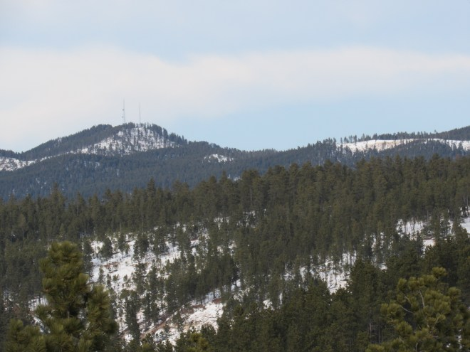 Veteran Peak (L), 4.5 miles due N of Flagstaff Mountain, with the help of the telephoto lens.