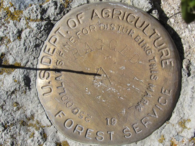 """This survey benchmark saying """"Ragged"""" was located up on the W high point of Ragged Top Mountain. The W high point was certainly more impressive and a better viewpoint than the E one. However, even after Lupe visited both, SPHP remained uncertain which high point is actually the true summit."""
