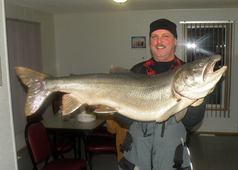 Ice fisherman catches near world-record 'monster' lake ...