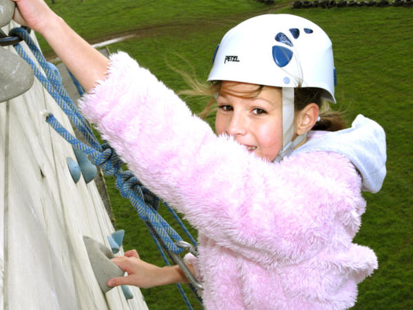 Girl Enjoying High Ropes Climbing Course