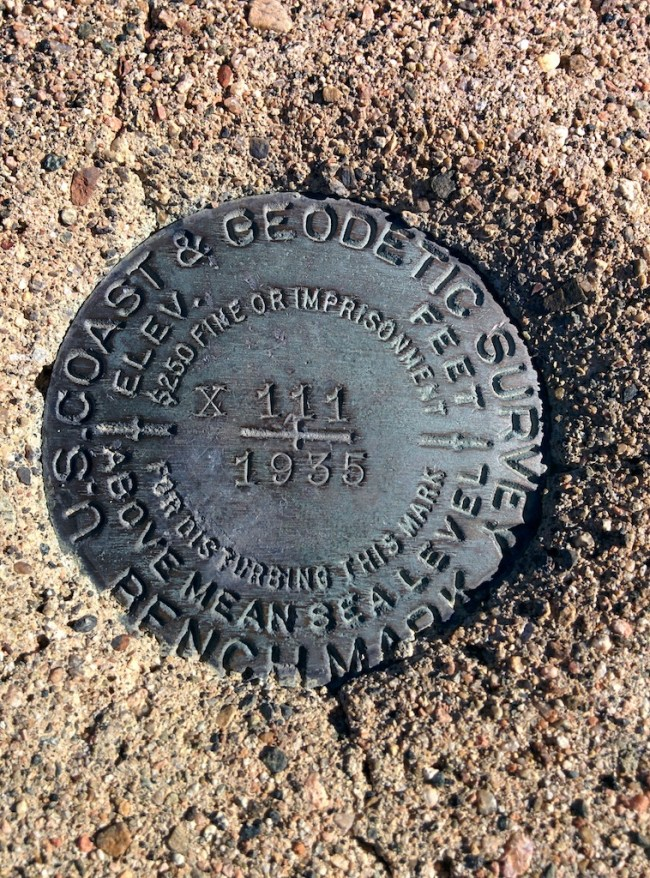 The plaque on the geodetic survey marker