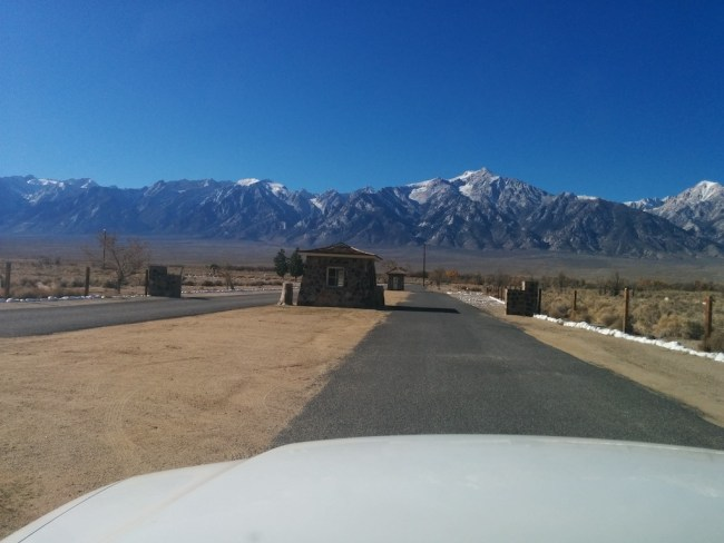 View of Whitney Range behind a guard house at Manzanar
