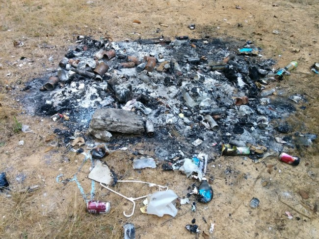 Burn pile of some scumbag's household garbage in the middle of a Humboldt forest