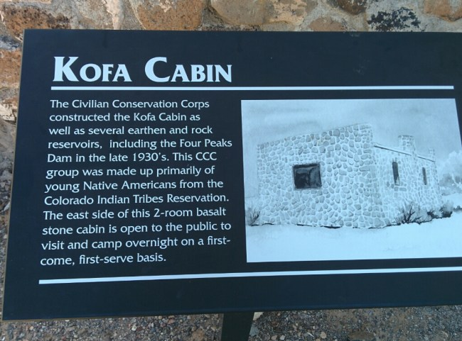 Sign about the history of the Kofa Cabin out in front
