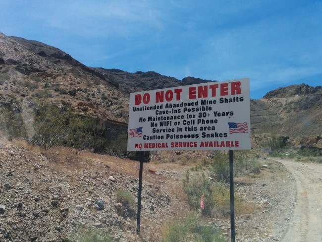 Mine Warning Sign with American flags on it