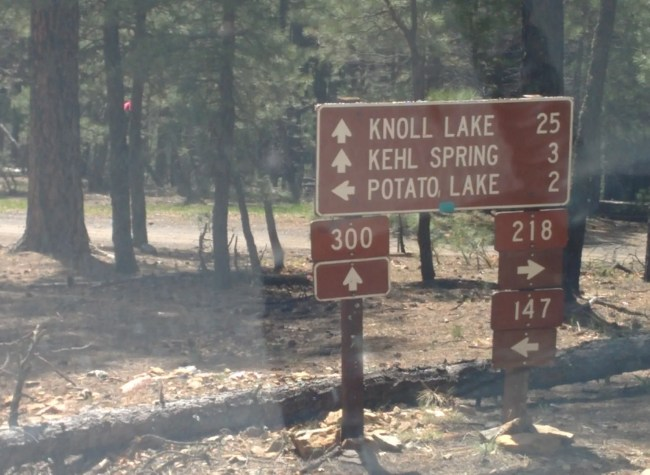 SIgn showing forest service roads and travel distances to Knoll Lake, Kehl Spring and Potato Lake