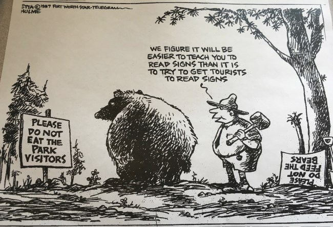 "Comic showing a ranger removing the old ""Please don't feed the bears"" sign and putting up a new sign that says ""Please Don't Eat The Park Visitors"" and saying to the bear ""we figure it will be easier to teach you to read signs than it is to get tourists to read signs."""
