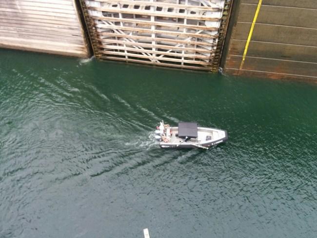 small zodiac boat entering In Through The Lock Doors