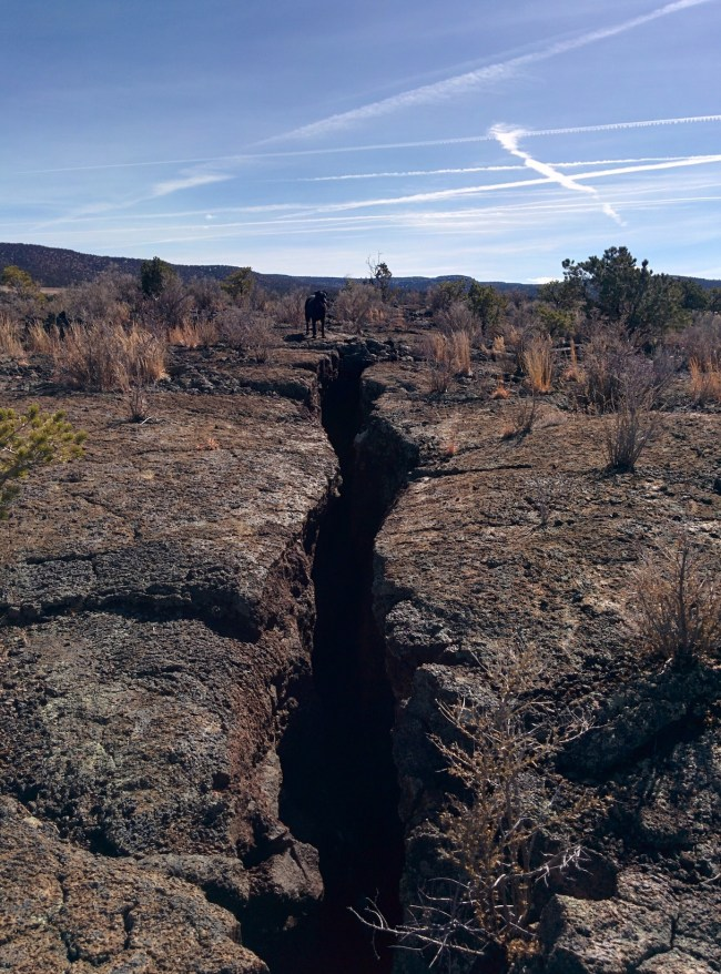 Willow standing Next To A large Fissure in the lava