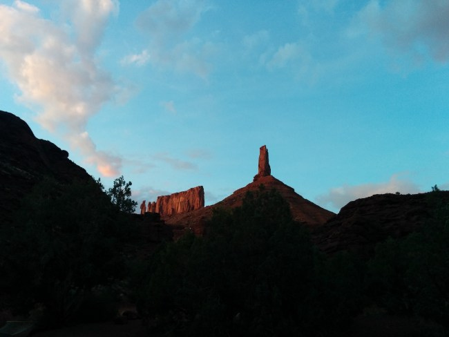 Castleton Tower and nearby rock formation in the twilight glow